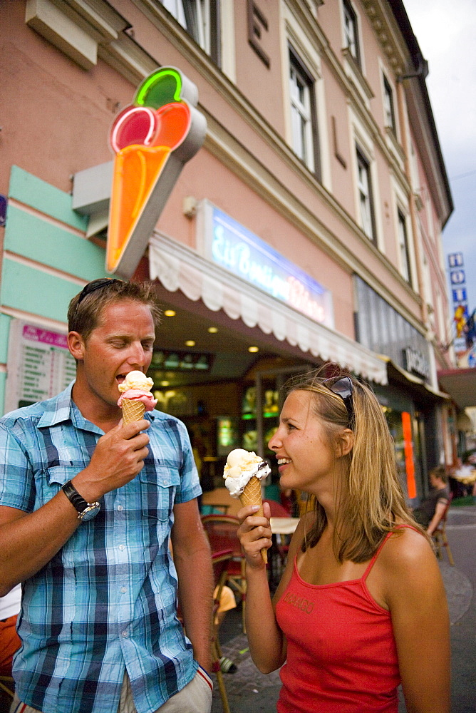 Young couple eating ice cream, Villach, Carinthia, Austria
