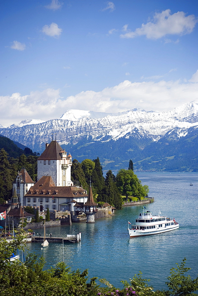 Excursion Boat at Castle Oberhofen at Lake Thun, Eiger (3970 m), Moench (4107 m) and Jungfrau (4158 m) in background, Oberhofen, Bernese Oberland (highlands), Canton of Bern, Switzerland