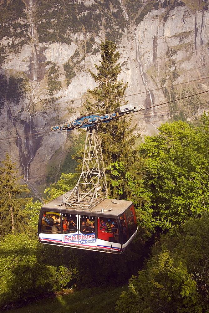 Fully occupied cabin of the Schilthornbahn on the way from Gimmelwald to Schilthorn, Gimmelwald near Muerren, Bernese Oberland (highlands), Canton of Bern, Switzerland