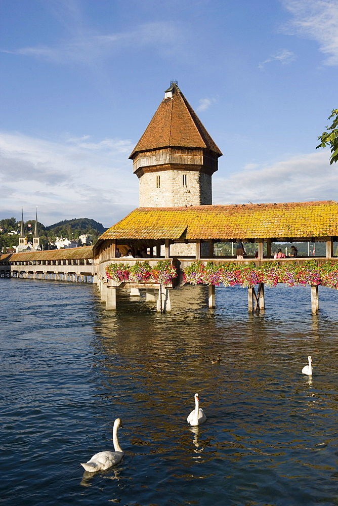 Reuss river with Kapellbruecke (chapel bridge, oldest covered bridge of Europe) and Wasserturm, Lucerne, Canton Lucerne, Switzerland