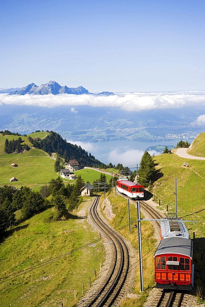 View over Rigi Kulm (1797 m) with rack railway Vitznau Rigi Bahn, the first mountain railway of Europe, mountain panorama with mount Pilatus (2132 m) in background, Rigi Kulm, Canton of Schwyz, Switzerland