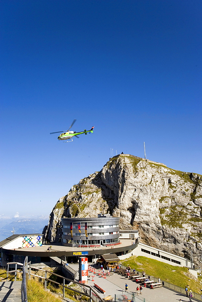 Helicopter flying over Hotel Bellevue in front of mount Esel (2118 m), panoramic view over Lake Lucerne, Pilatus (2132 m), Pilatus Kulm, Canton of Obwalden, Switzerland
