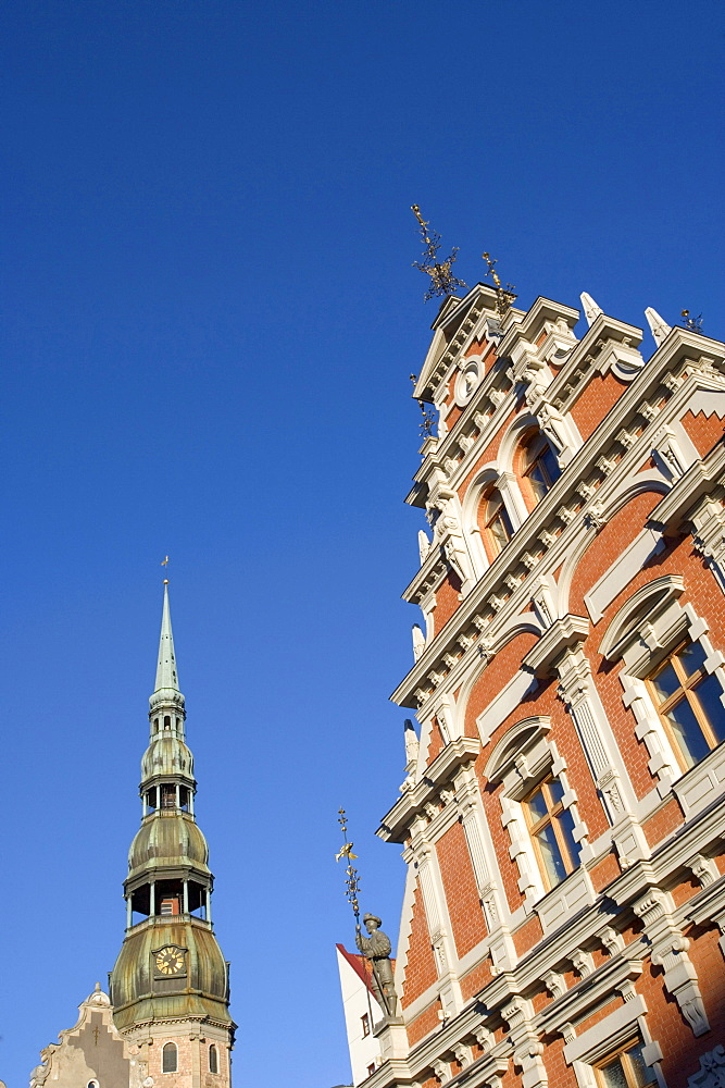 House of the Blackheads guild and church tower of Saint Peters church, Riga, Latvia