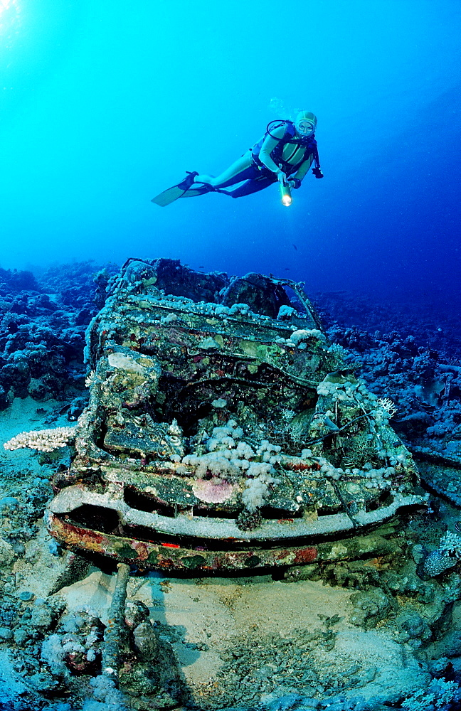 Scuba diver and Car wreck near Blue Belt shipwreck, Sudan, Africa, Red Sea