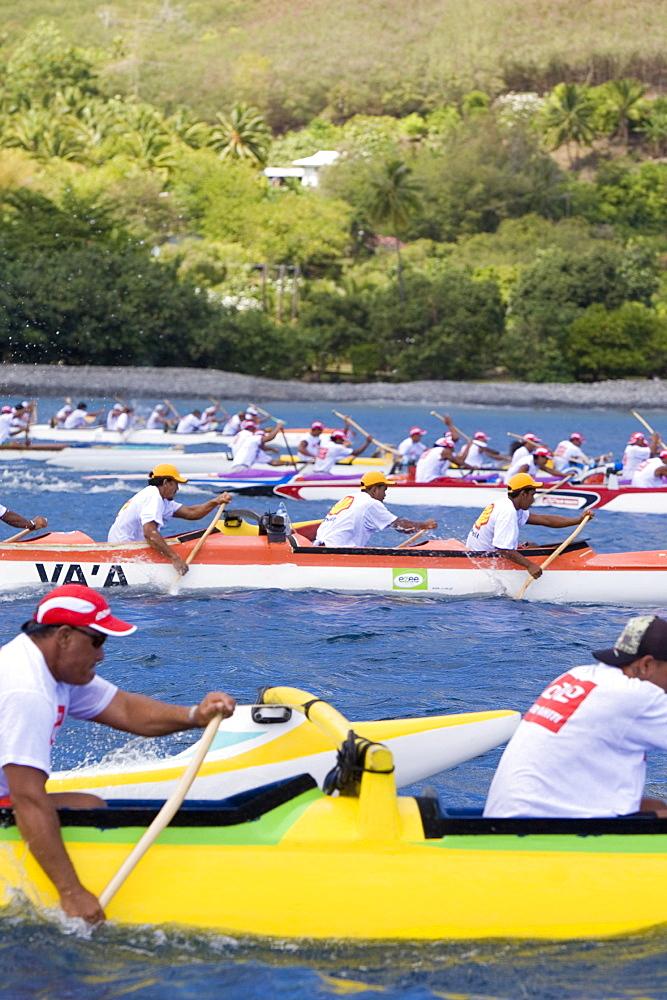 Men in canoos paddling, Ua Pou, Marquesas, Polynesia, Oceania