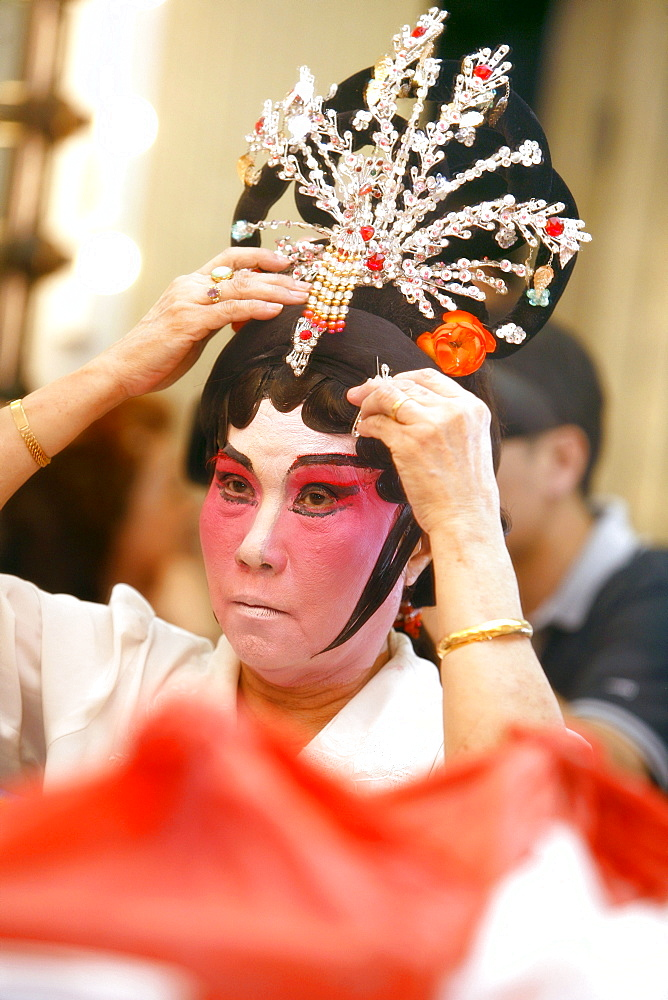Woman in mask, Chinese Opera at the Kreta Ayer Theatre, Chinatown, Singapore