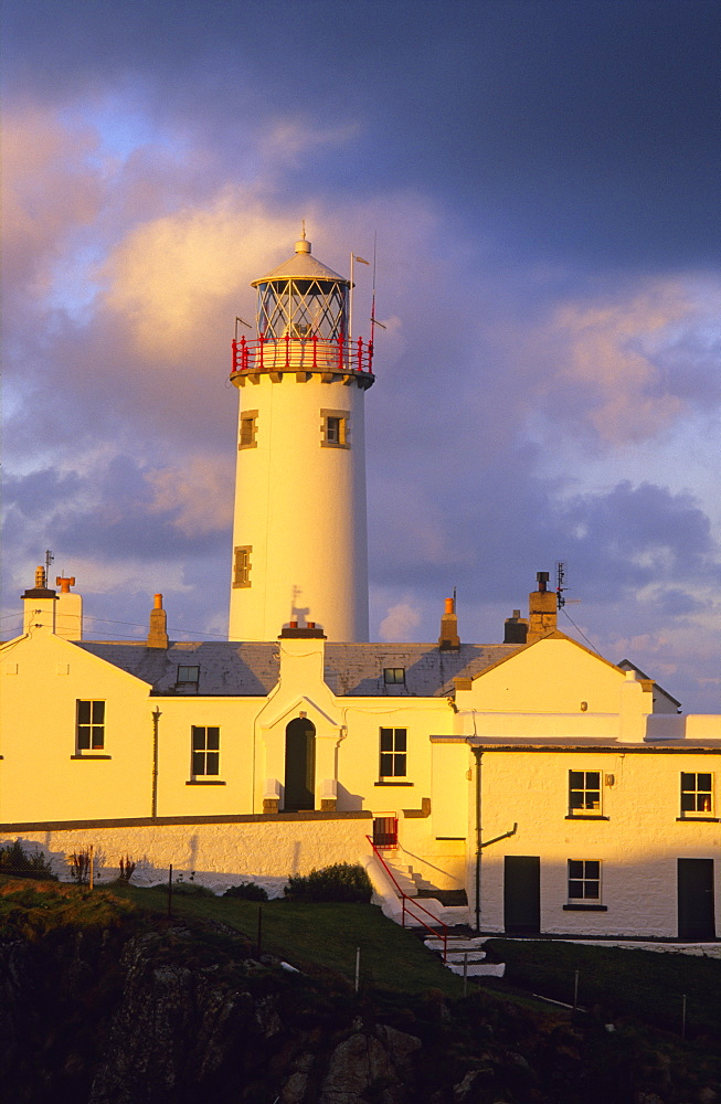 Lighthouse at Fanad Head in the light of the evening sun, County Donegal, Ireland, Europe