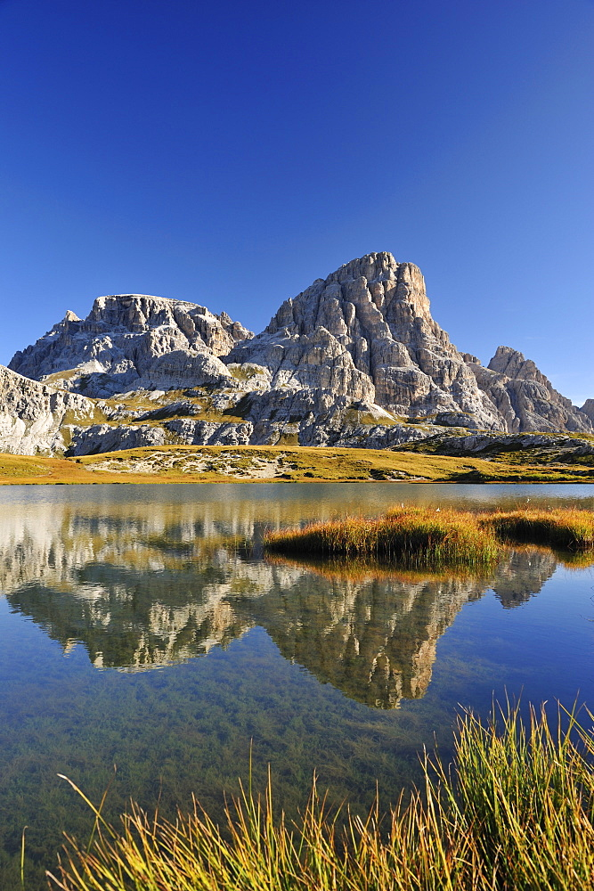 Lake Boedensee with Schusterplatte, Tre Cime di Lavaredo range, Dolomites, UNESCO World Heritage Site, South Tyrol, Italy