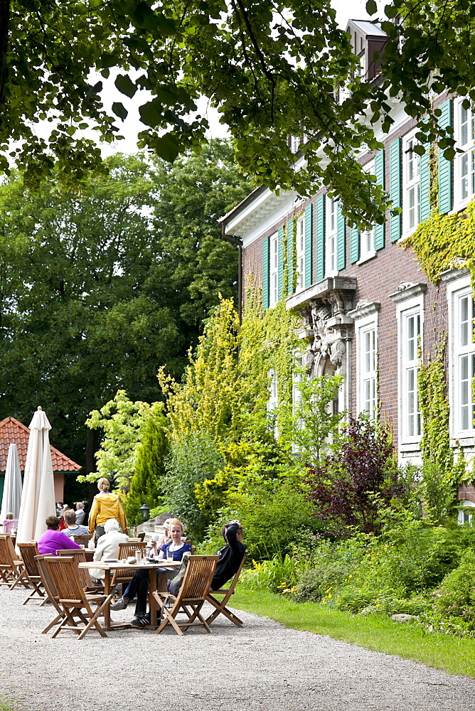 Guests sitting at tables in front of the main building, wellness hotel, Hotel Gutshaus Stellshagen, area Kluetzer Winkel, coast of the Baltic Sea, Stellshagen, Mecklenburg-West Pomerania, Germany