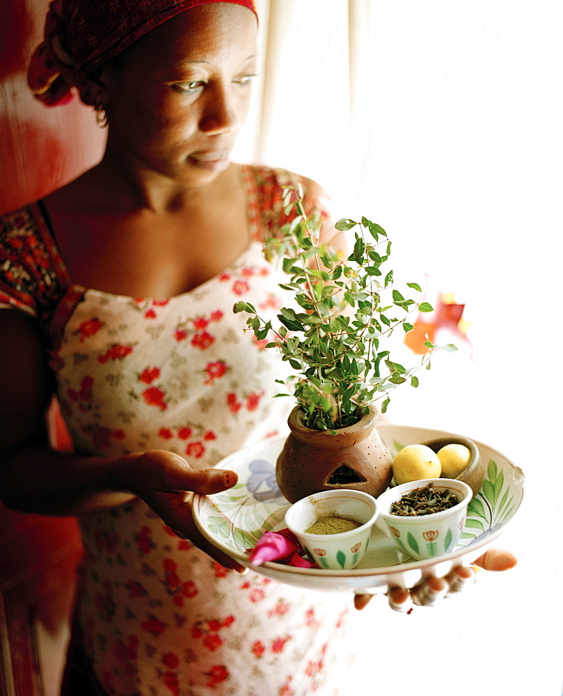 Therapist Acha shows ingredients for henna paste, Mrembo Spa, Mrembo means beautiful woman, old house in the center of Stone Town, Zanzibar, Tanzania, East Africa