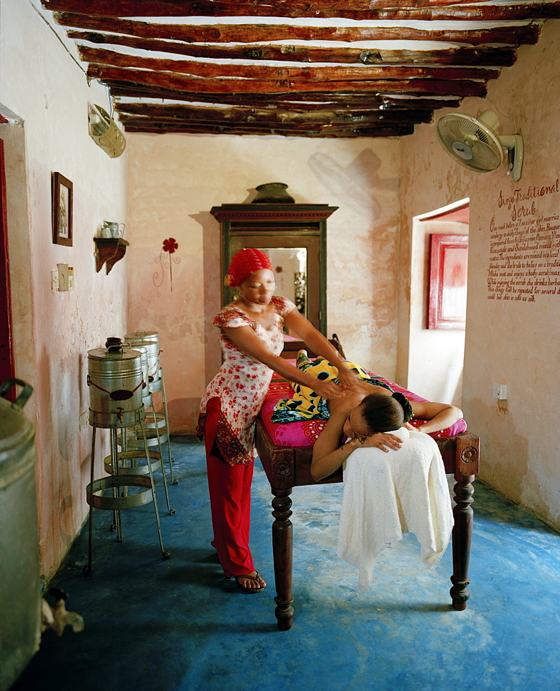 Therapist Acha giving a massage at Mrembo Spa, Mrembo means beautiful woman, old house in the center of Stone Town, Zanzibar, Tanzania, East Africa