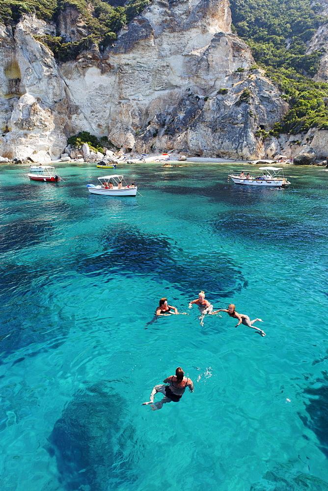 People bathing off Cala Felci beach, Island of Ponza, Pontine Islands, Lazio, Italy, Europe