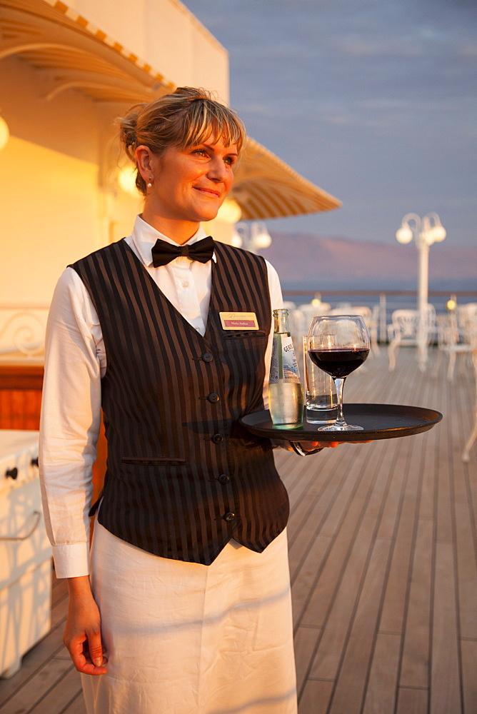 Golden waitress Maria aboard cruise ship MS Deutschland, Reederei Peter Deilmann, South Pacific Ocean, near Chile, South America