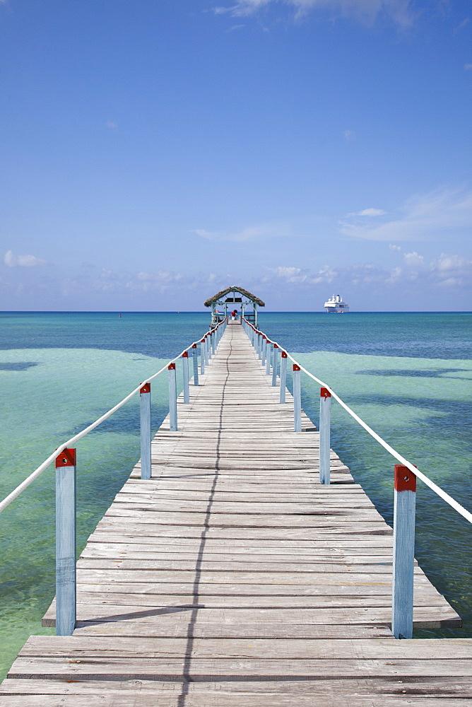 Pier at Punta Frances Parque Nacional with cruise ship MS Deutschland (Reederei Peter Deilmann) in the background, Isla de la Juventud, Cuba, Caribbean