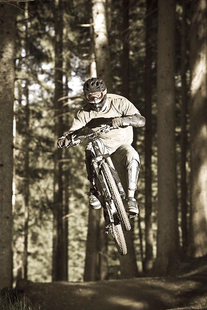 A teenager on his mountain bike during a jump, Downhill Park, Wagrain, Austria