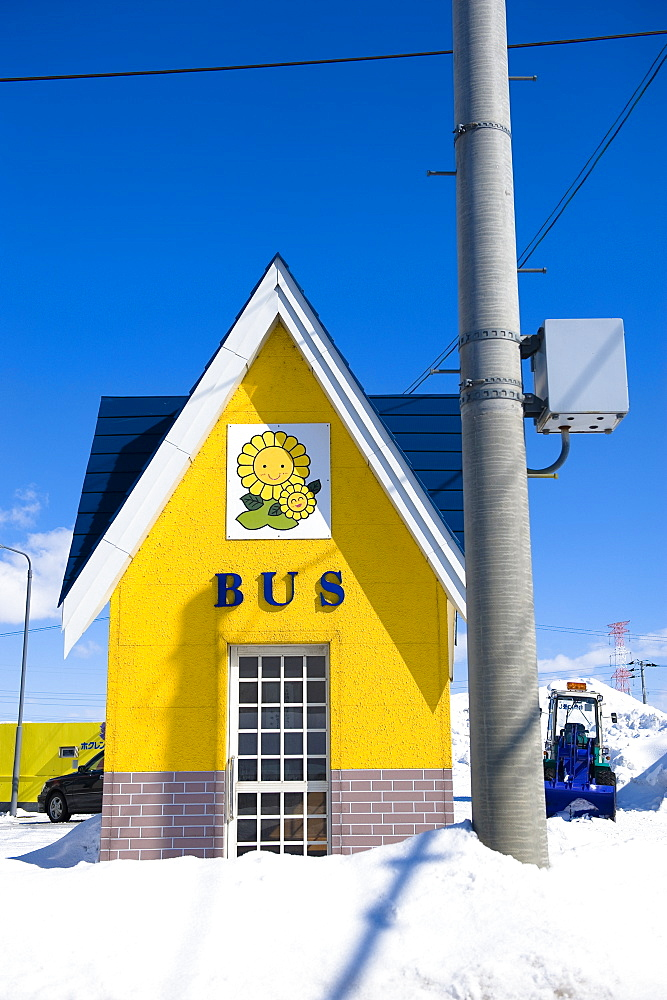 Bus shelter at the bus stop in the snow under blue sky, Hokkaido, Japan, Asia