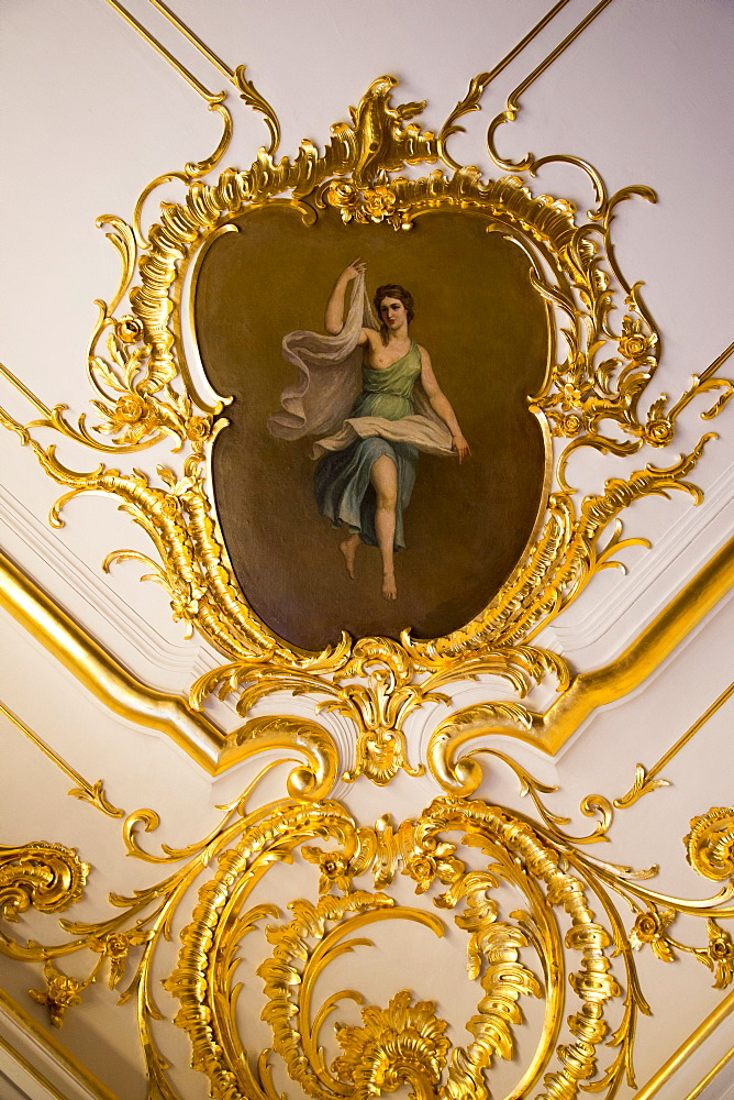 Golden decoration and painting on ceiling inside Catherine Palace, Tsarskoye Selo, Pushkin, near St. Petersburg, Russia, Europe