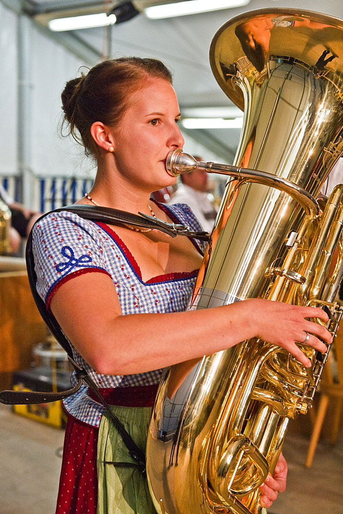 Young woman playing the tuba, Christening of a bell, Antdorf, Bavaria, Germany