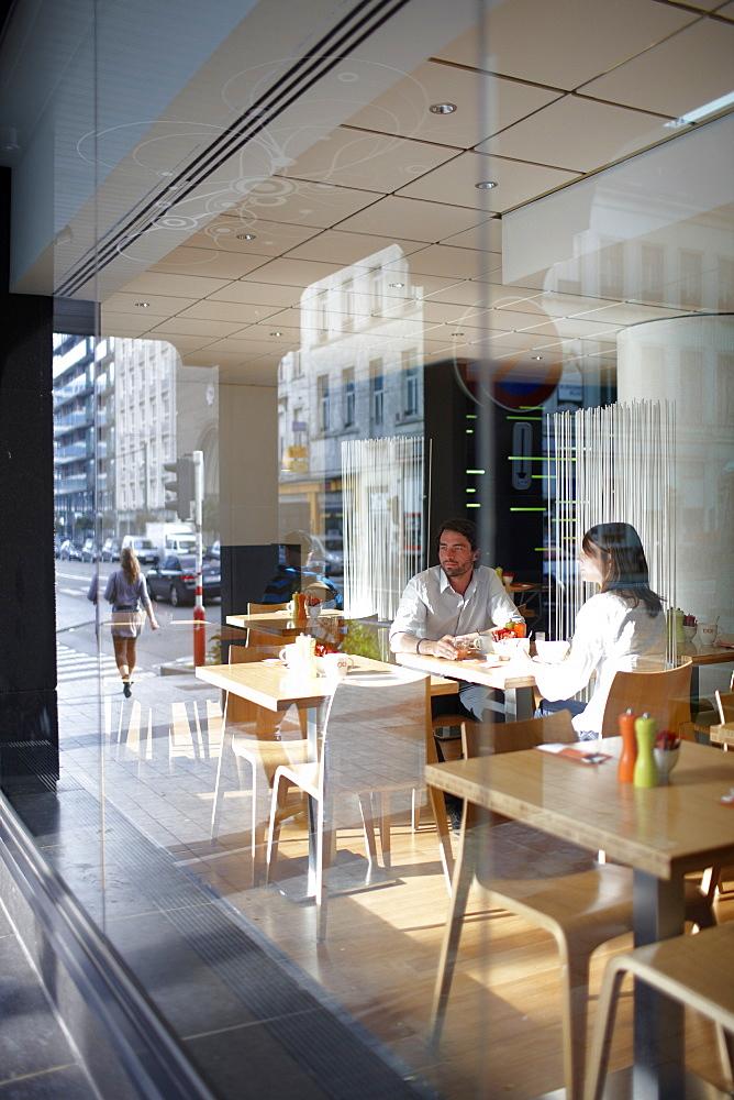 Couple inside a breakfast restaurant of a hotel, Brussels, Belgium
