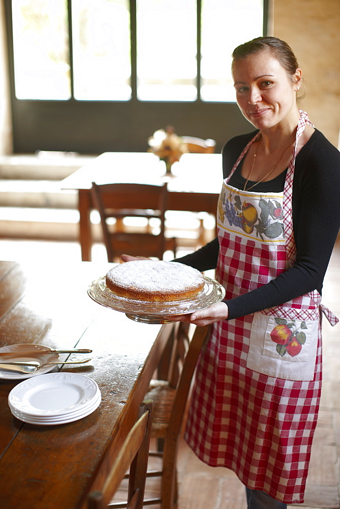Woman with breakfast cake, Agriturismo and vineyard Ca' Orologio, Venetia, Italy