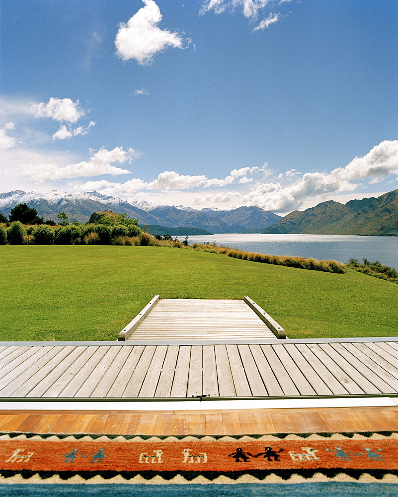 Terrace and garden of luxury Whare Kea Lodge in the sunlight, Lake Wanaka, Wanaka, Central Otago, South Island, New Zealand