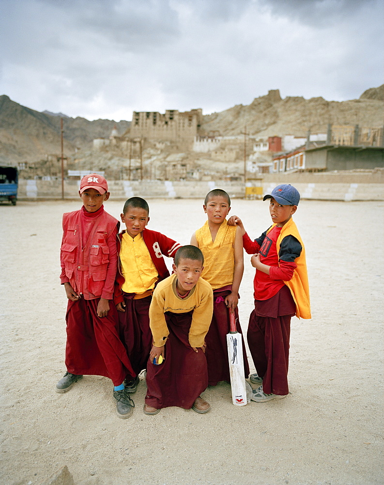 Jun-Juns, young monks playing cricket on a polo yard underneath Royal Palace, Leh, Ladakh, Jammu and Kashmir, India