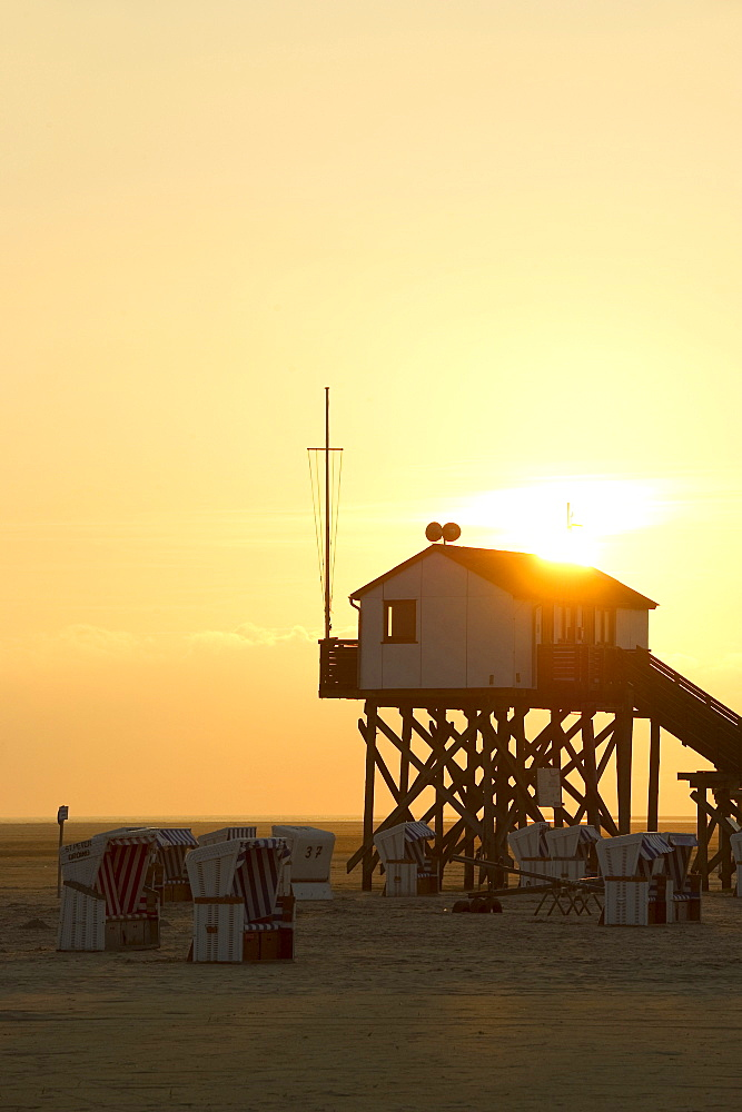 Stilt house on the beach at sunset, Sankt Peter-Ording, Wadden Sea National Park, Eiderstedt peninsula, North Frisian Islands, Schleswig-Holstein, Germany, Europe