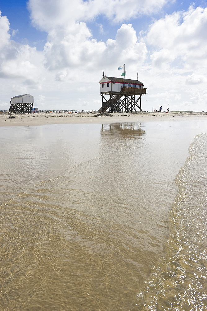 Stilt houses on the beach, Sankt Peter-Ording, Wadden Sea National Park, Eiderstedt peninsula, North Frisian Islands, Schleswig-Holstein, Germany, Europe