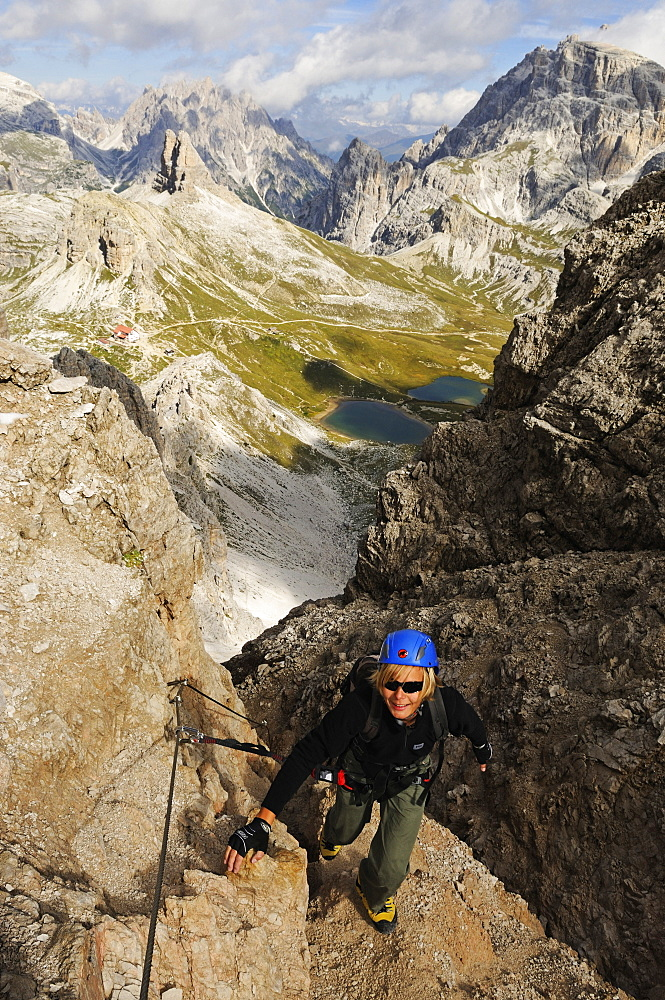 Teenager climbing on the Paternkofel fixed rope route, via ferrata, Boedenseen, Hochpustertal, Dolomites, South Tyrol, Italy