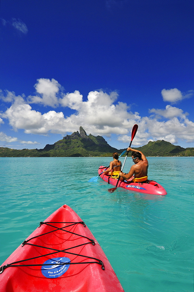 Couple with paddel boat, Bora Bora, Society Islands, French Polynesia, Windward Islands, South Pacific