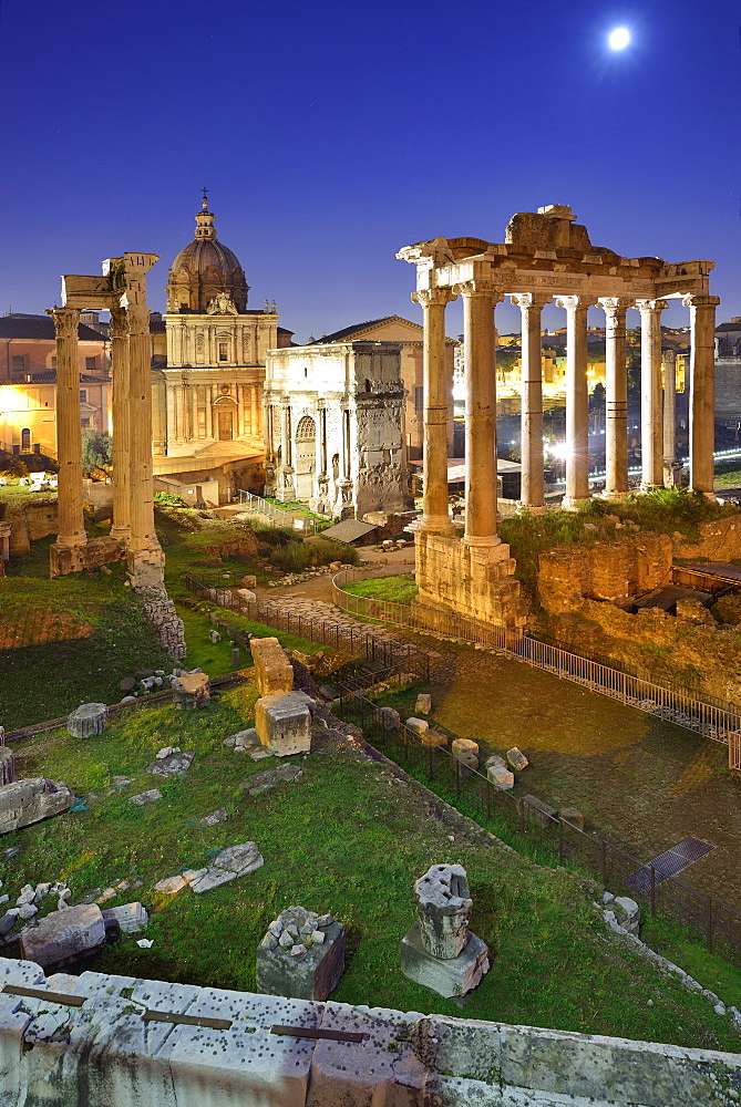 Illuminated Roman Forum at night with temple of saturn in the middle, UNESCO World Heritage Site Rome, Rome, Latium, Lazio, Italy