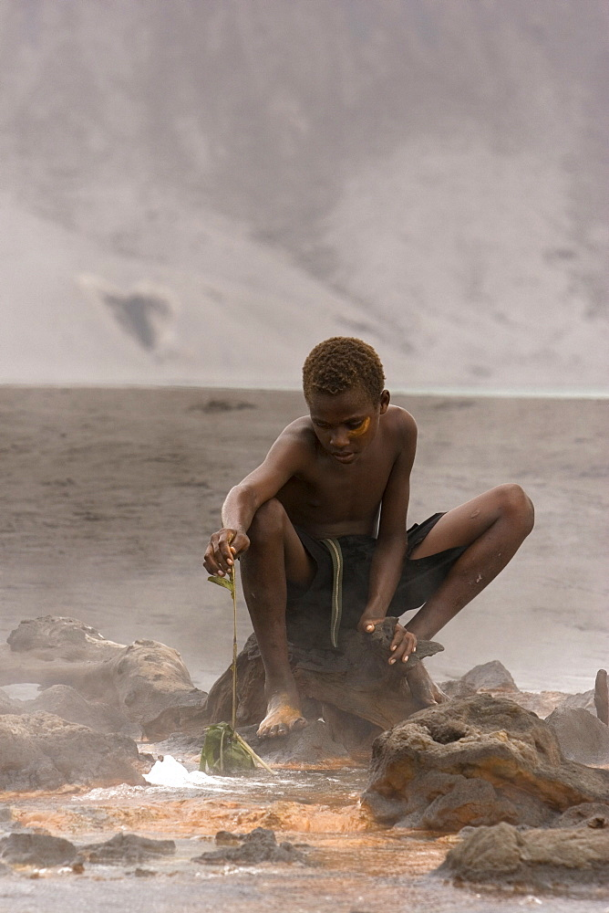 The Hot Springs opposite the Volcano are colored by volcanic minerals. They are also a location where the locals come to boil eggs from the Megapode bird, found on the slopes of the volcano. Tavurvur Volcano, Rabaul, East New Britain, Papua New Guinea, Pacific