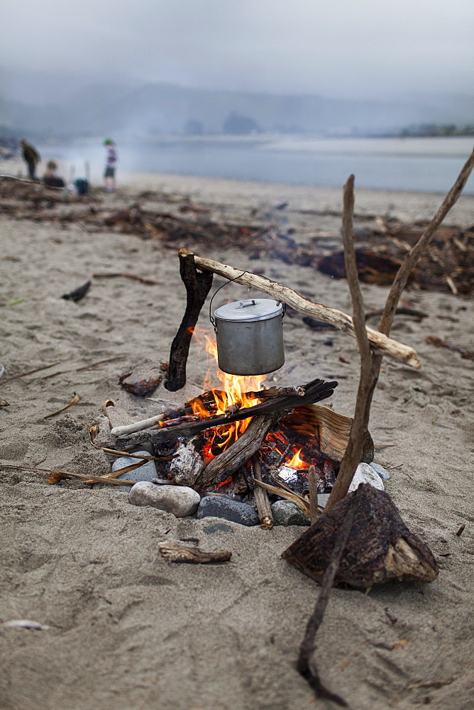 Cooking over a campfire on the beach, billy can, South Island, New Zealand