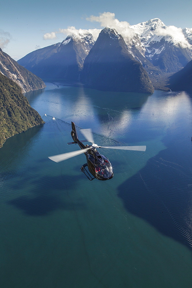 Aerial view of Milford Sound with helicopter below, Mitre Peak, Fiordland National Park, South Island, New Zealand