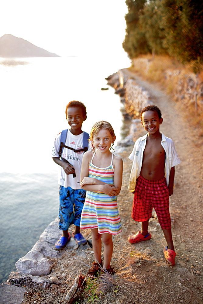 Children on the path along the bay near Hotel Sipan, Sipanska Luka, Sipan island, Elaphiti Islands, northwest of Dubrovnik, Croatia