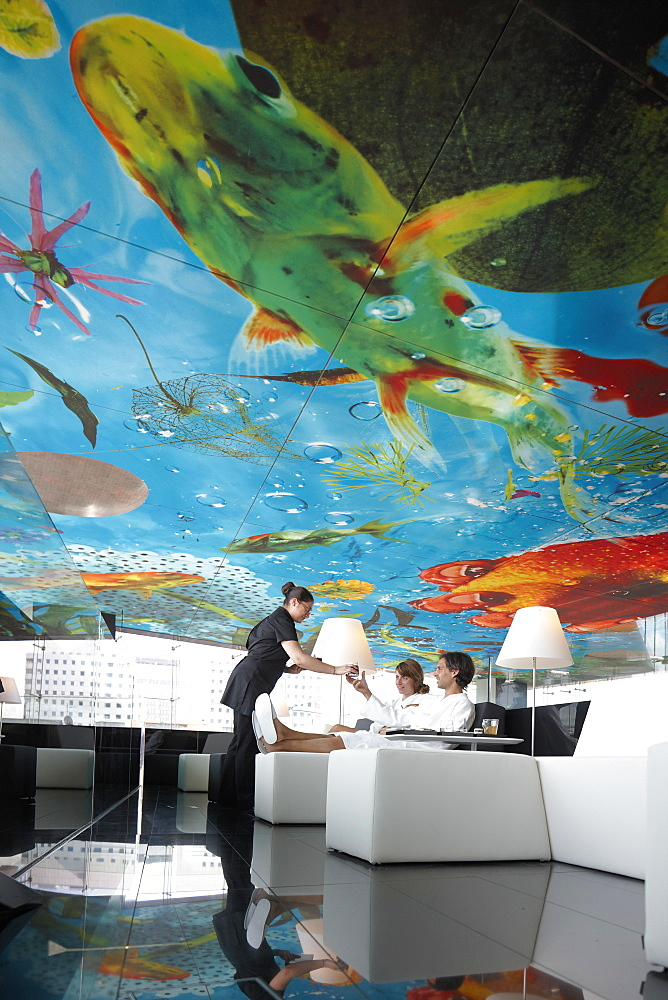 Guests in one of the relaxation lounges in the spa area with view over the city center of Vienna, ceiling designed by Pippilotti Rist, Hotel Sofitel Vienna Stephansdom, architect Jean Nouvel, Vienna, Austria