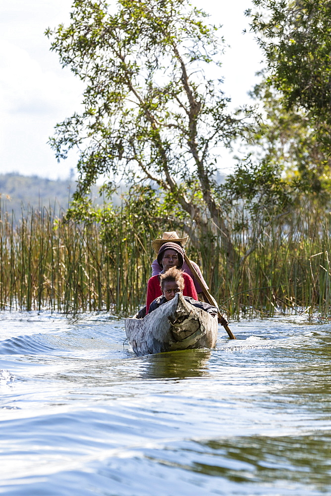 Family in dug out canoe, Canal de Pangalanes, East Madagascar, Africa