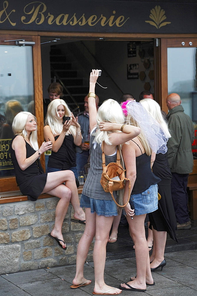 Young women celebrating hen party, St. Ives, Cornwall, England, United Kingdom