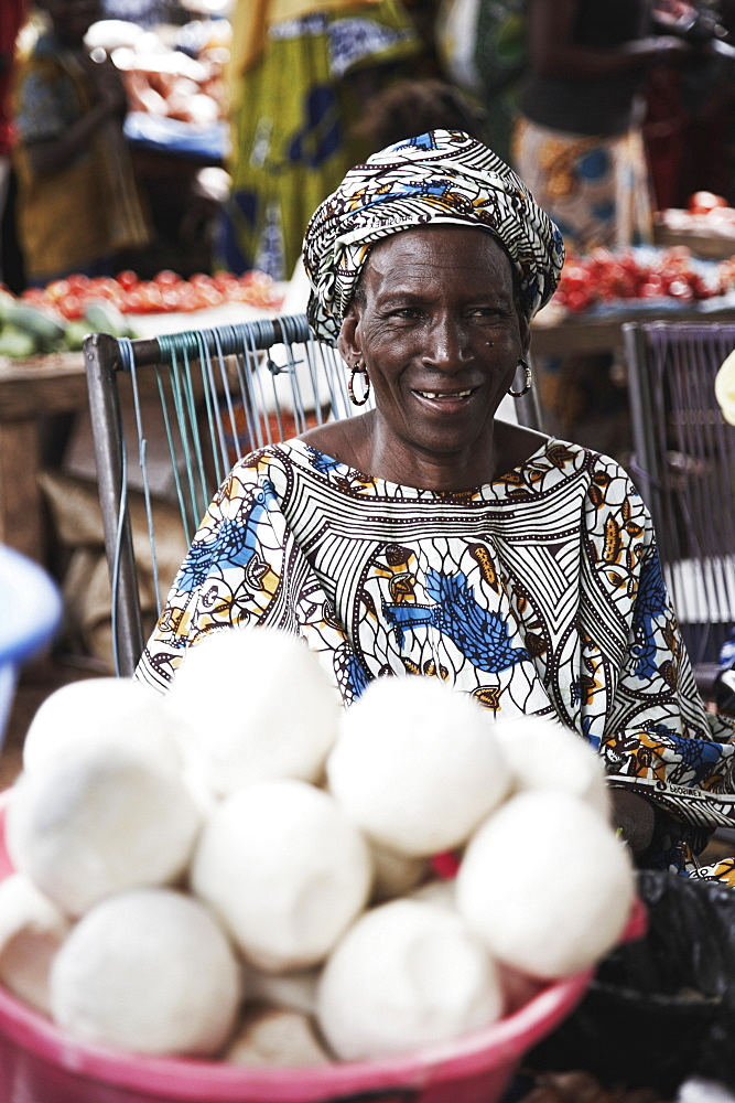 Woman offering soap at a market, Yanfolila, Sikasso Region, Mali