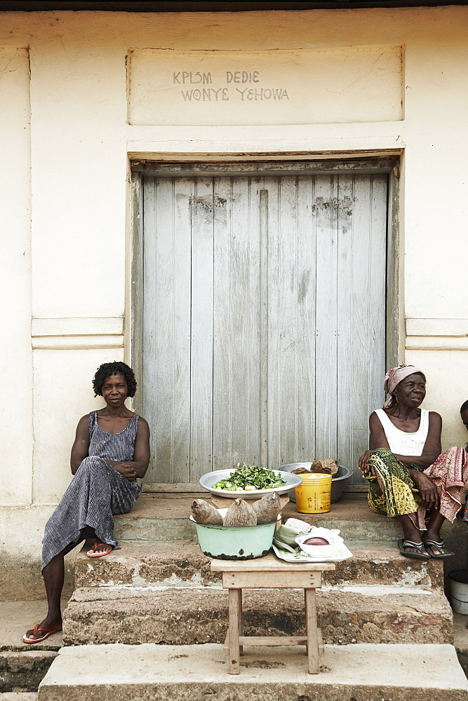 Market women sitting on stairs, Lake Volta, Asuogyaman District, Ghana