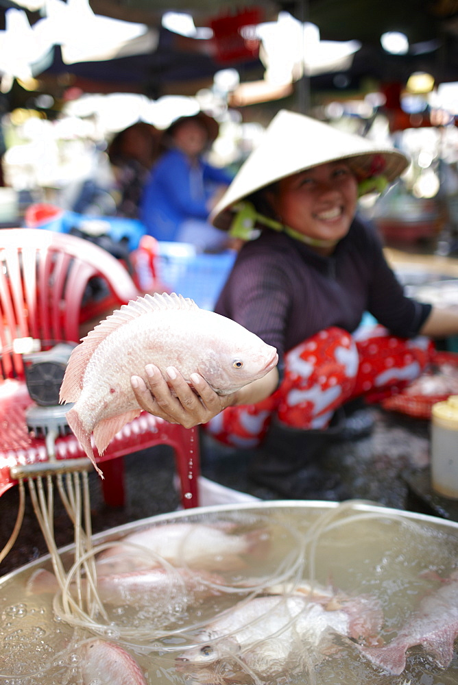 Woman offering fresh fish on market, Sa Dec, Dong Thap, Vietnam