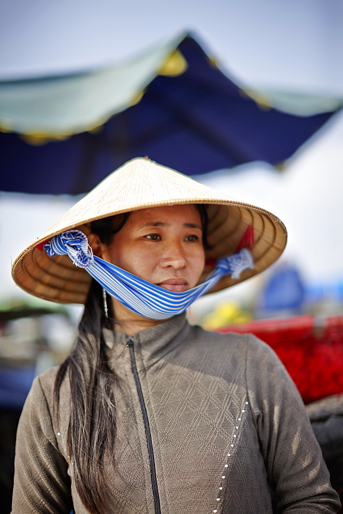Woman selling coffee, floating market on Mekong river, Long Xuyen, An Giang Province, Vietnam