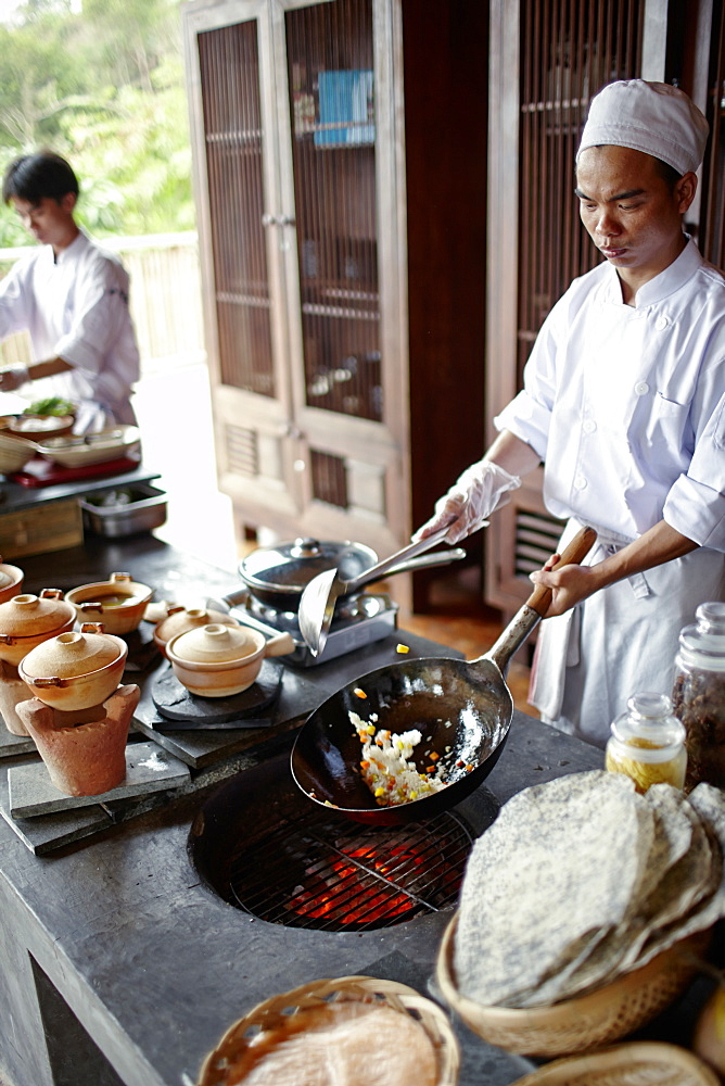 Chefs cooking in open kitchen of a hotel, Dat Doc Beach, Con Dao Island, Con Dao National Park, Ba Ria-Vung Tau Province, Vietnam
