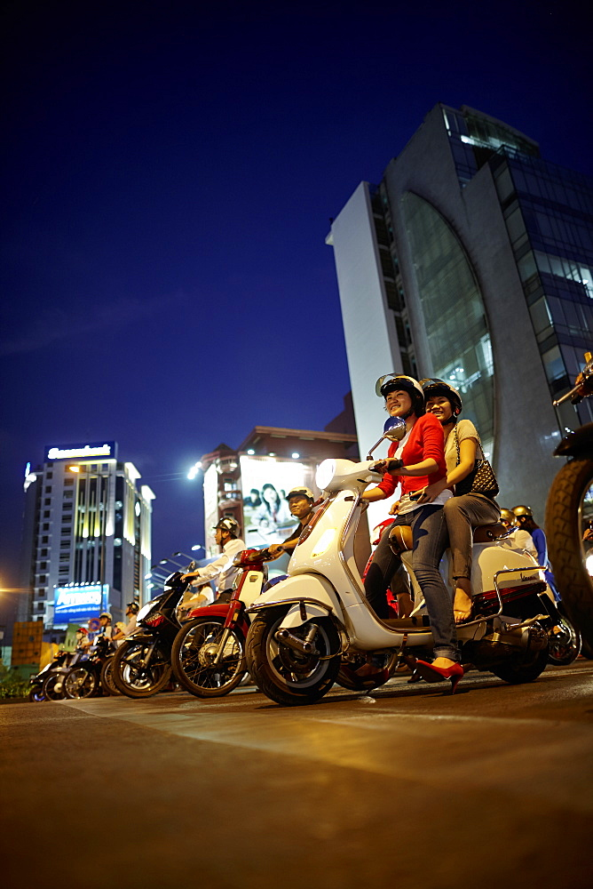 Scooterists at night, Ho-Chi-Minh City, Vietnam