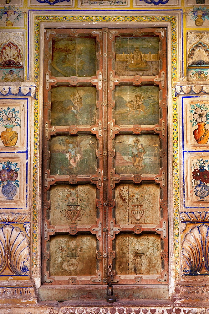 Ancient ornated wooden portal inside Mehrangarh Fort, Jodhpur, Rajasthan, India