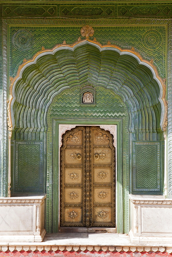 Richly ornated gate into the City Palace, Jaipur, Rajasthan, India