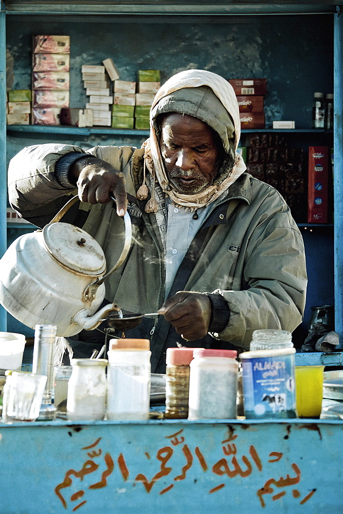 Man preparing tea in his kiosk, Wadi Halfa, Sudan, Africa