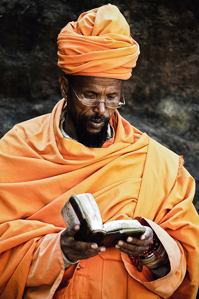 Priest reading the bible, Lalibela, Ethiopia, Africa