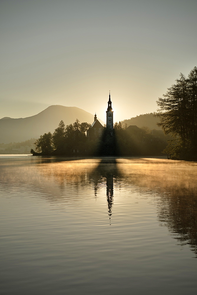 View at St Mary Church in early morning at tiny island of Lake Bled, Julian Alps, Gorenjska, Slovenia