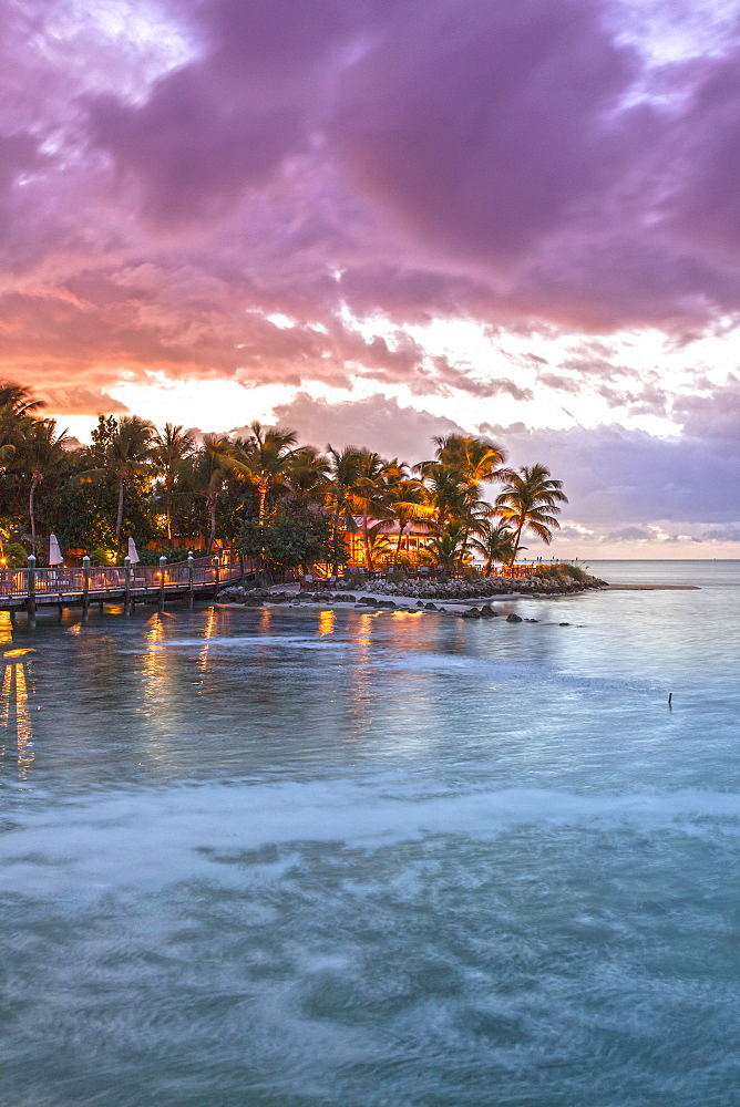 Restaurant DINING ROOM after sunset, Little Palm Island Resort, Florida Keys, USA